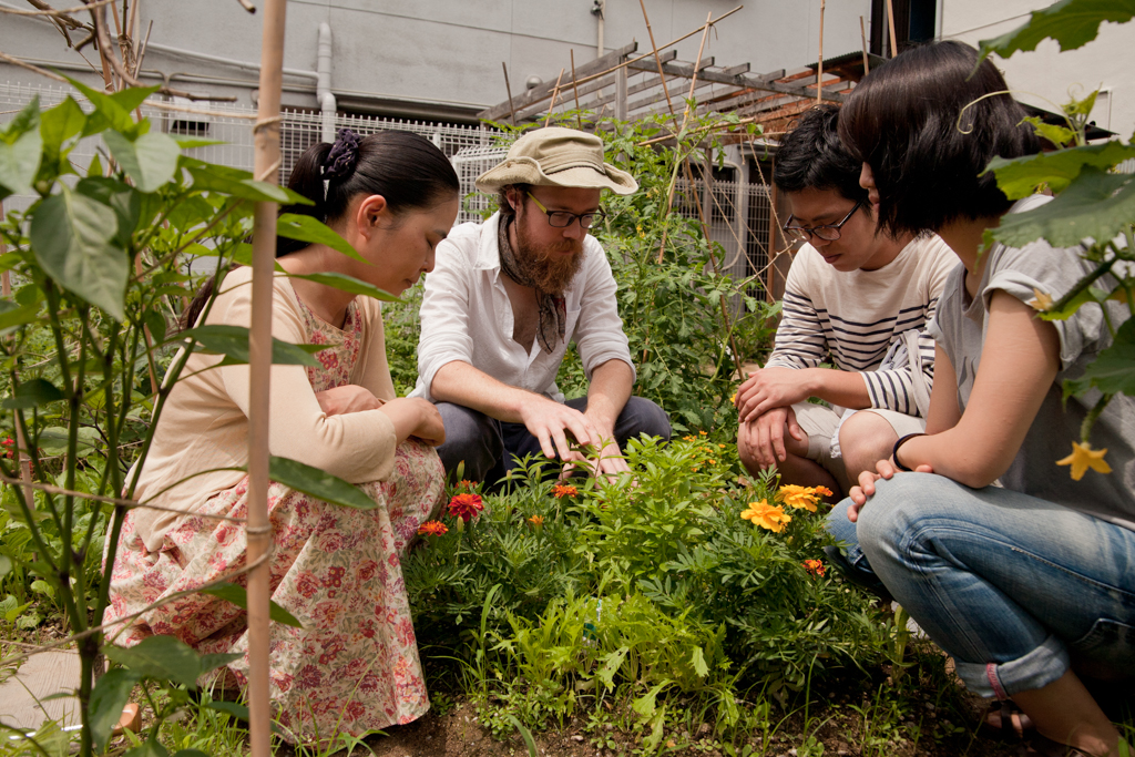 Patrick leads a 'nature sensing' workshop in our urban garden in Osaka, Japan
